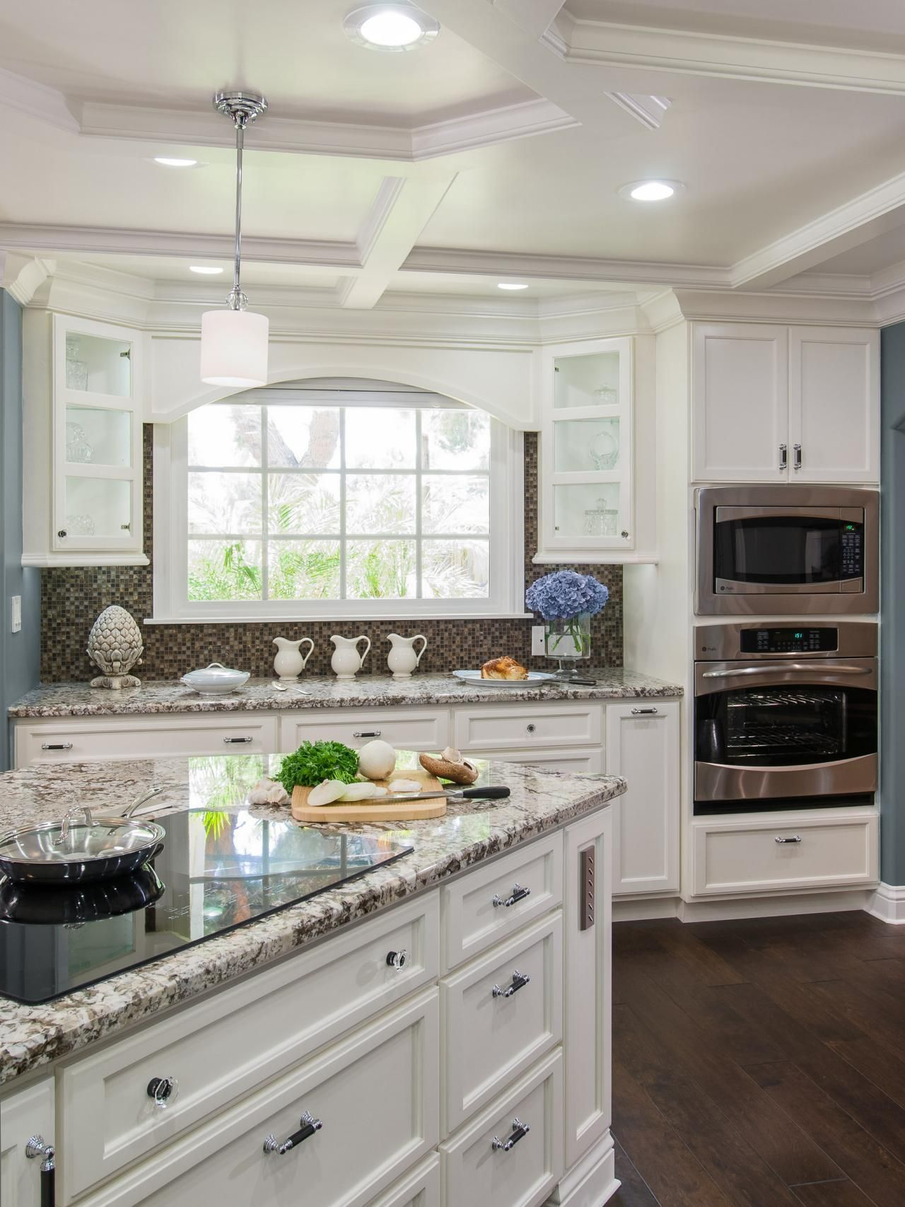 Kitchen with white cabinets and induction cooktop buying guide for kitchen induction cooktops