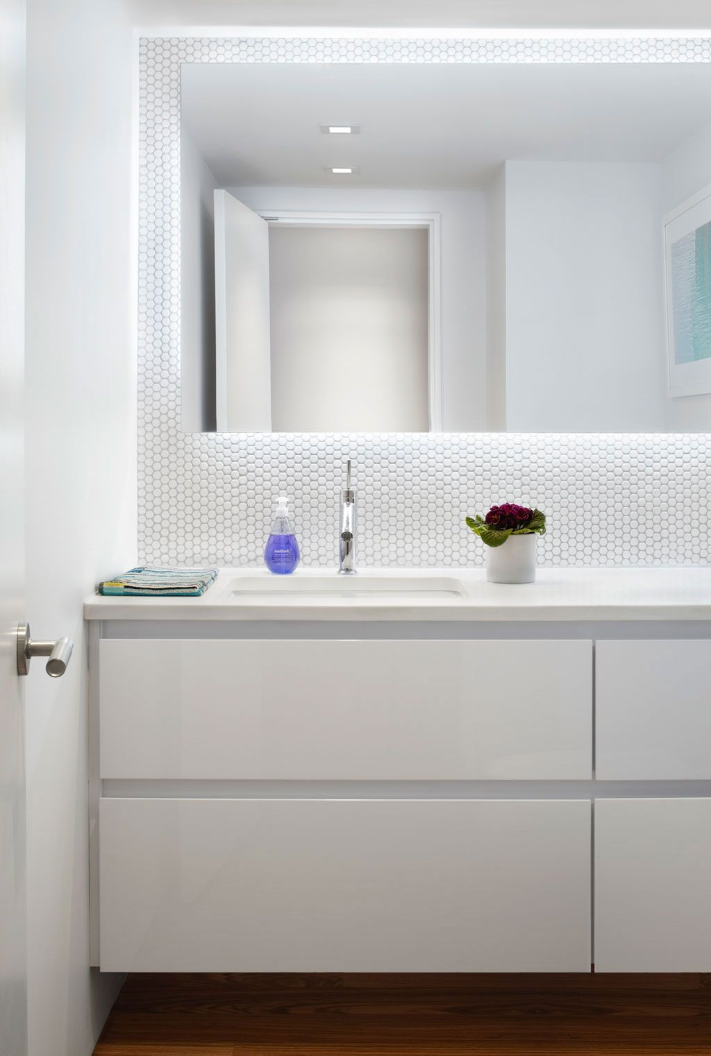 White bathroom Colourful and Light Filled Apartment in Manhattan by ...