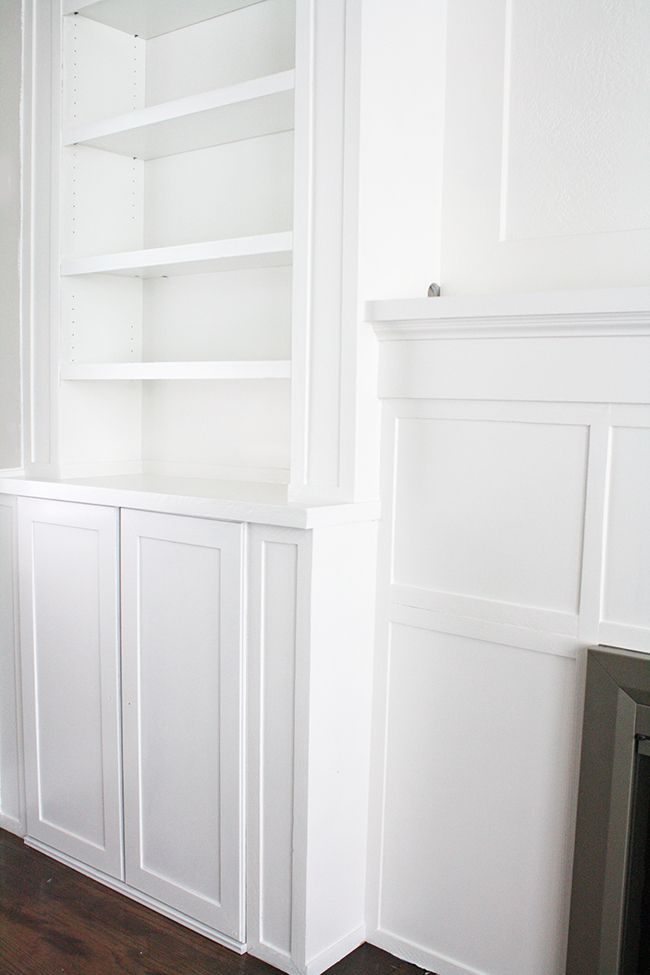 ikea hack built ins use inexspensive ikea cabinet and billy bookcase to make custom cabinets around fireplace - How To Make Custom Built In Bookshelves