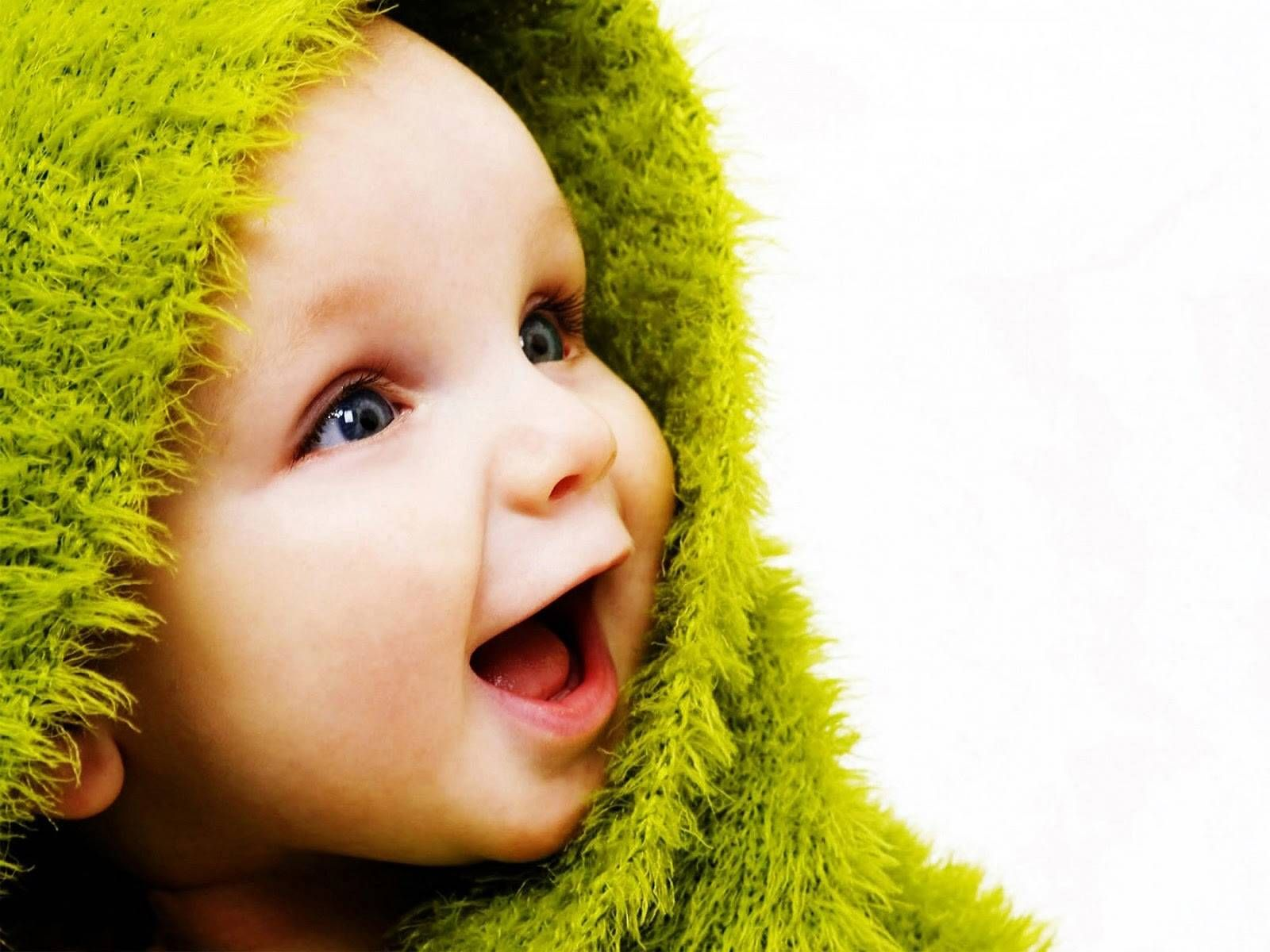109312-cute-baby-laughing-baby-with-a-green-fluffy-towel (1600