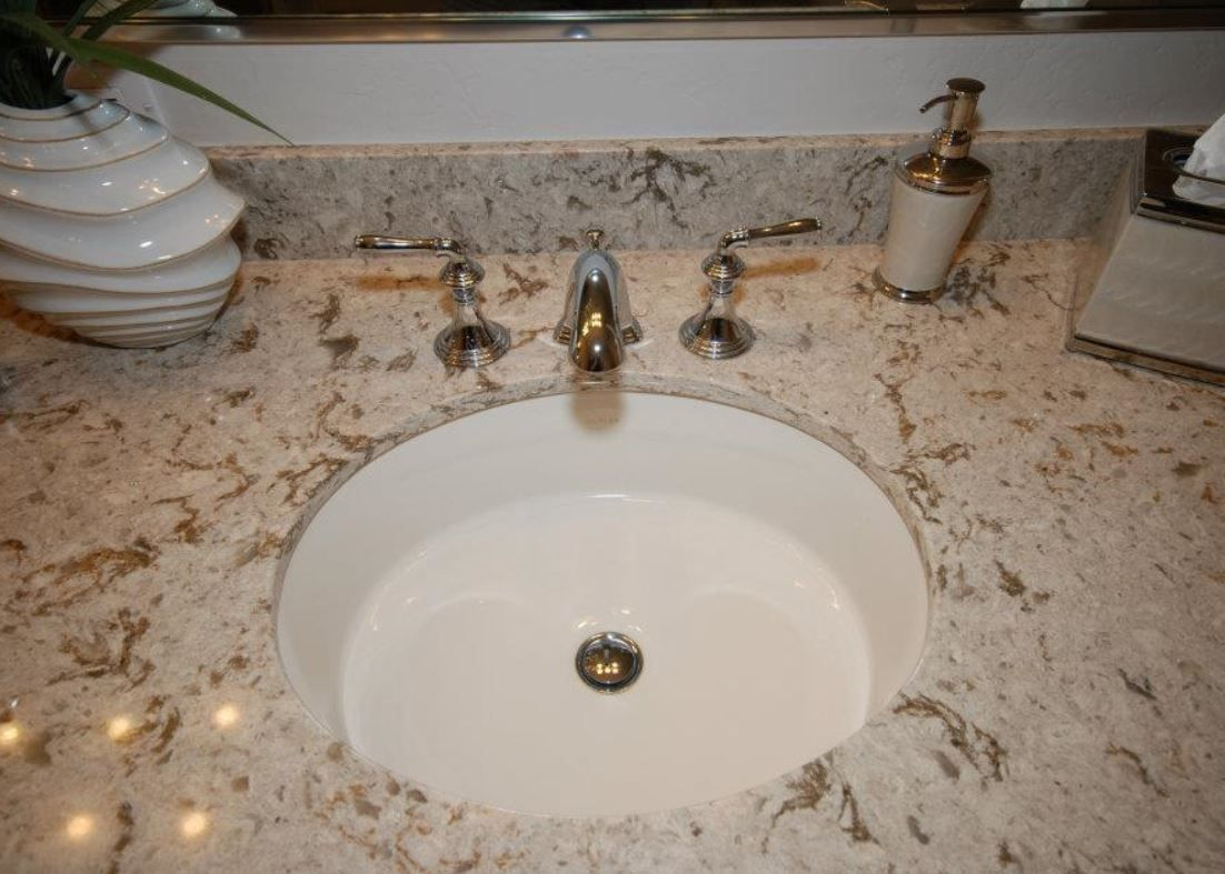 Cambria Quartz Windermere with Kohler Verticyl oval sink in biscuit ...