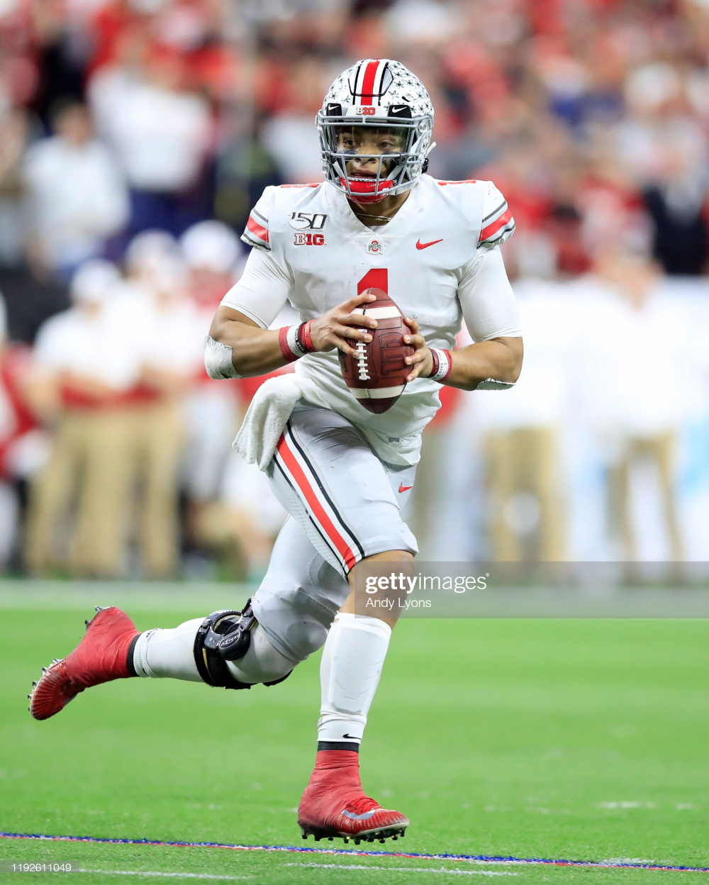Justin Fields of the Ohio State Buckeyes runs with the ball in the...