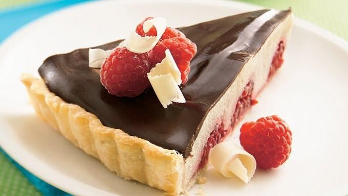 White and Dark Chocolate Raspberry Tart - Recipe: http://www.tablespoon.com/recipes/white-and-dark-chocolate-raspberry-tart/8c20e0ee-d3db-465e-9085-00ca756178e0/