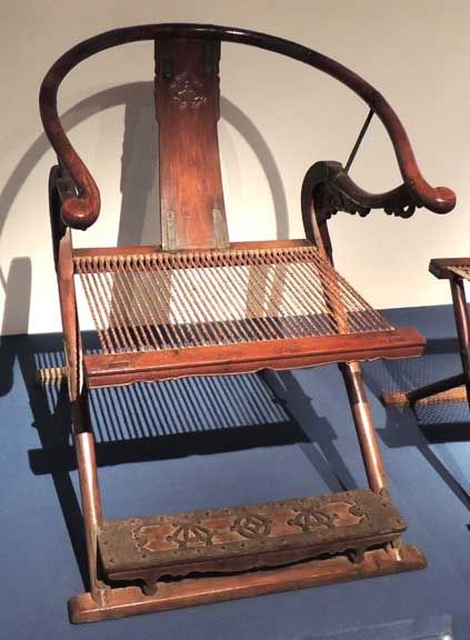 Chinese Furniture- Folding Armchair, Ming Dynasty. Handwritings and paintings by well-known calligraphers and painters were engraved in desks and chairs, increasing the artistic and aesthetic value of the furniture. Zhou Tianqiu, a Ming calligraphy master, was so fond of his red sandalwood chair that he wrote on the backrest, 'sitting on this chair, I feel one day is worth two days. If I live for 70 years, it would be worth 140 years.'