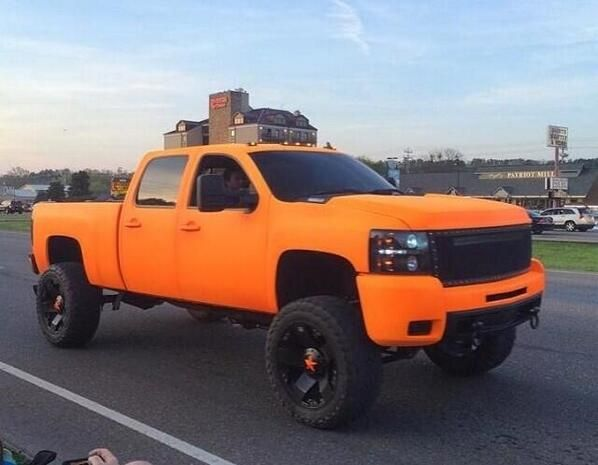 Orange Lifted Chevrolet Chev Silverado Truck This Would Be My Dream Truck If I Had Enough Money Jacked Up Trucks Lifted Chevy Trucks Lifted Trucks