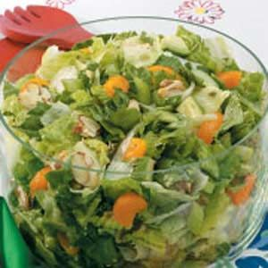 Almond-Orange Tossed Salad ~ Make this pretty salad, with its slightly-sweet homemade dressing and crispy sugar-toassted almonds the hightlight of your Easter menu.