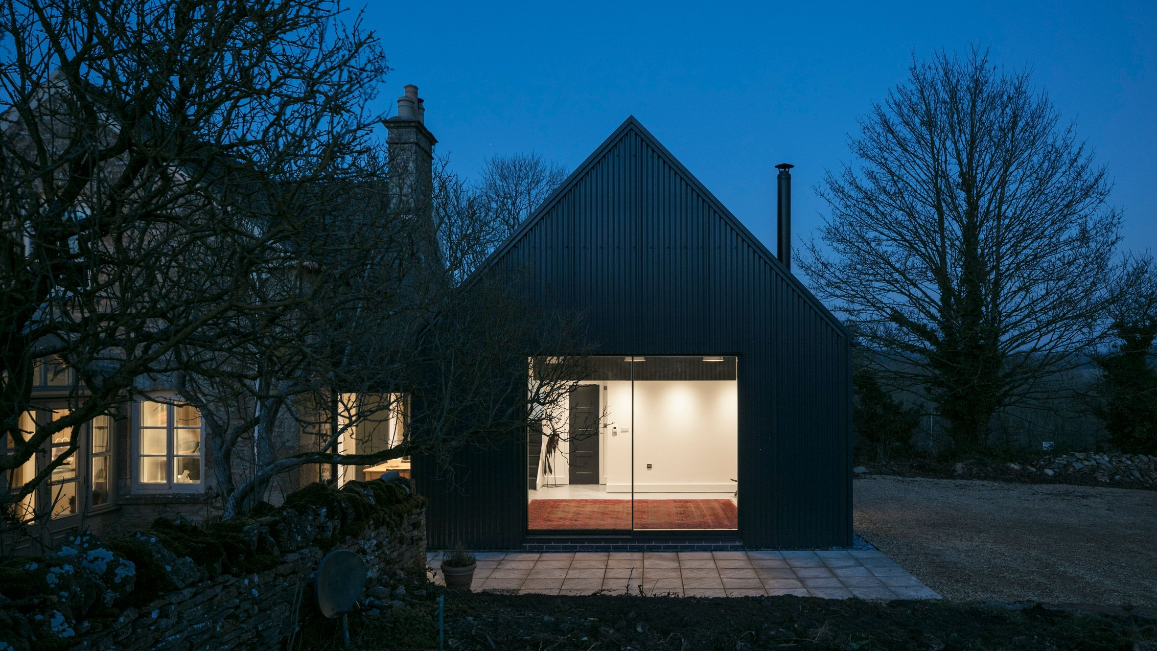 Corrugated Metal Extension By Eastabrook Architects The Structure Uses Timber Structural Insulated Panels Si Cotswolds Cottage Stone Cottage Barn Style House