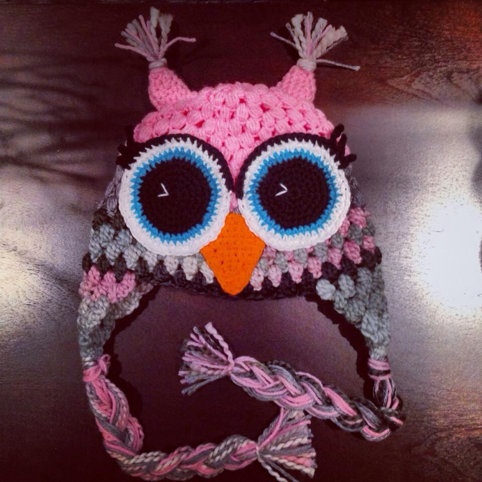 Crochet owl earflap hat made with the puff stitch.  I really like the eyelashes