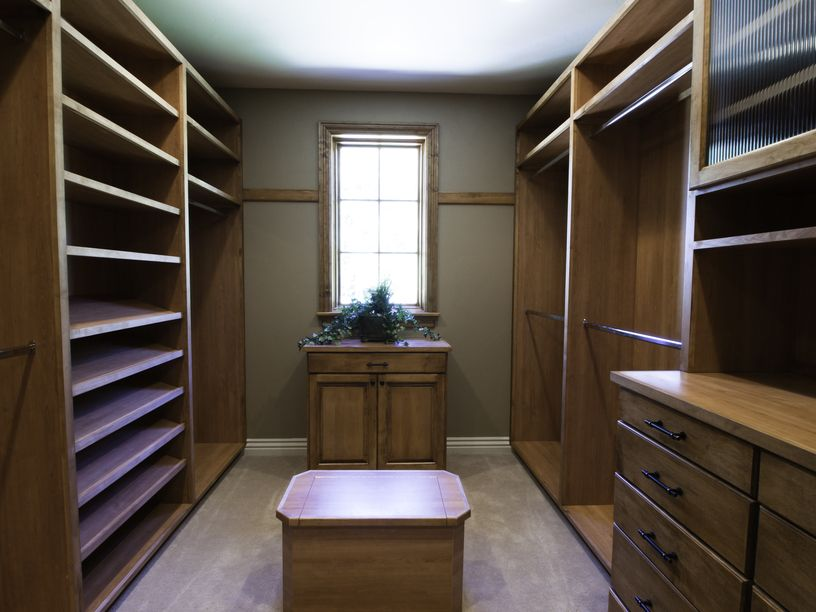 Large luxury walk in closet room with window