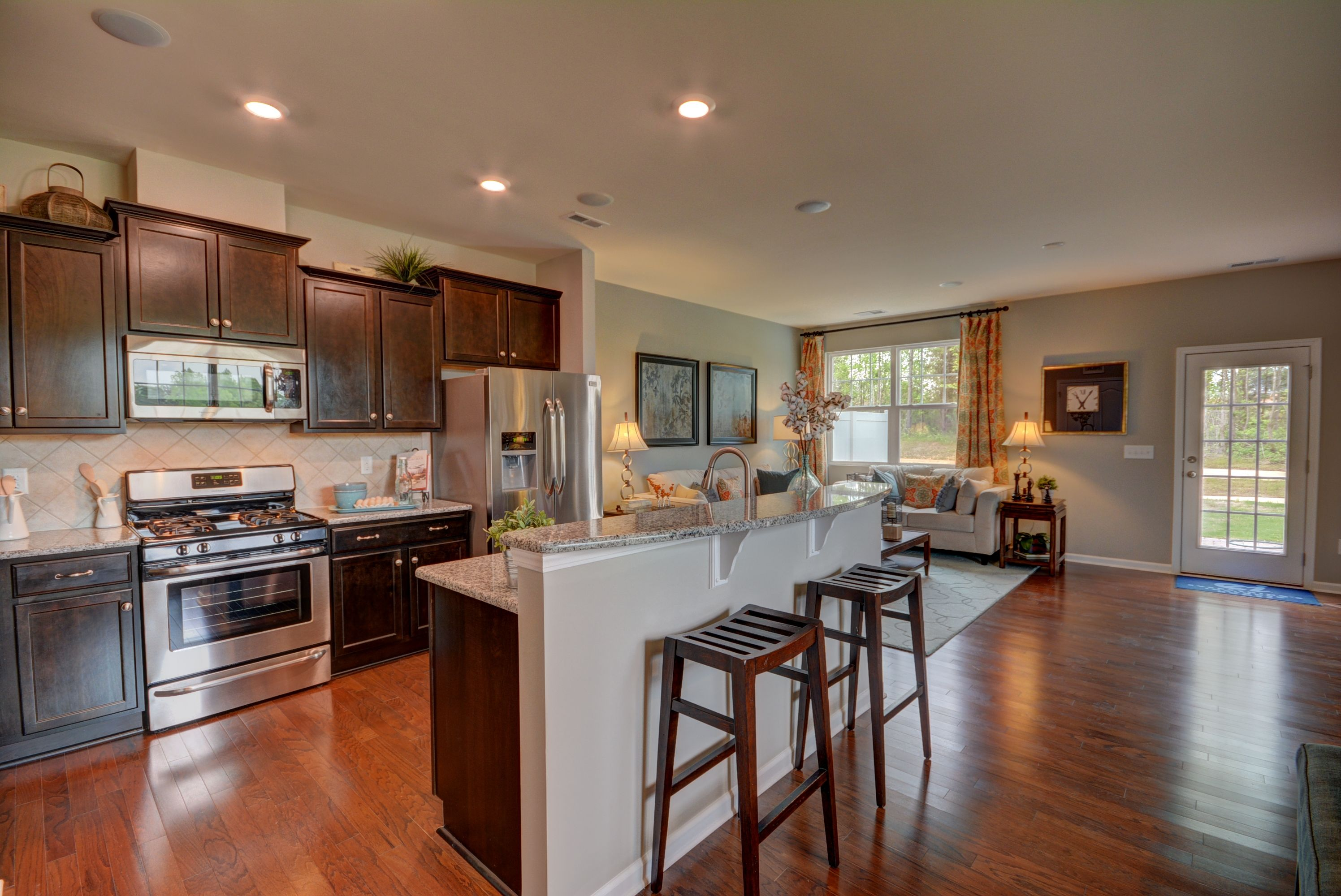 extra bar seating at a smaller island opens up a kitchen and creates the perfect spot for on kitchen remodel with island open concept id=43314