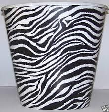 I A Small Zebra Print Trash Can From