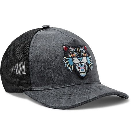 a4e9c38ce92 GUCCI GUCCI - ANGRY CAT APPLIQUÉD COATED-CANVAS AND MESH BASEBALL CAP -  CHARCOAL.  gucci