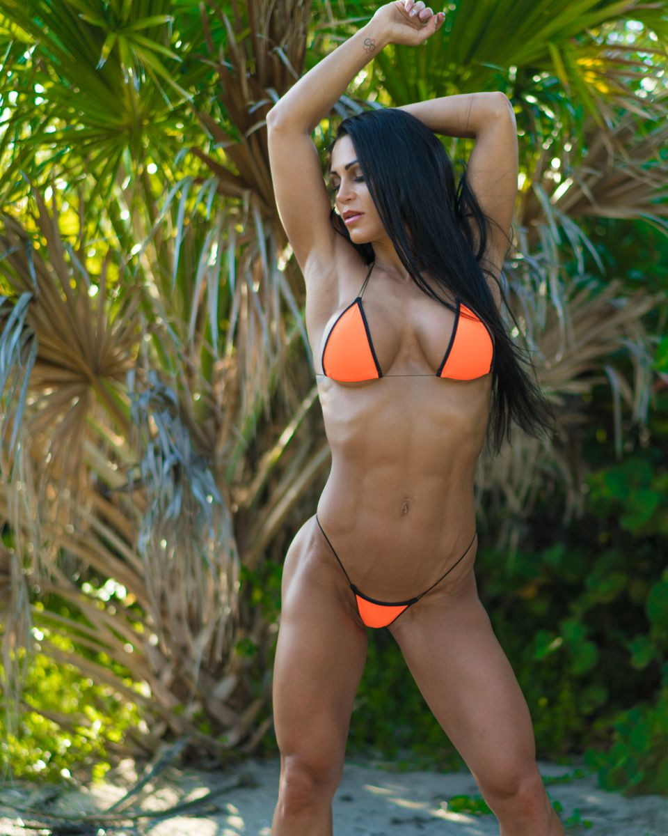 0b47f6849d38 Anita wearing our neon orange and black extreme string bikini ...