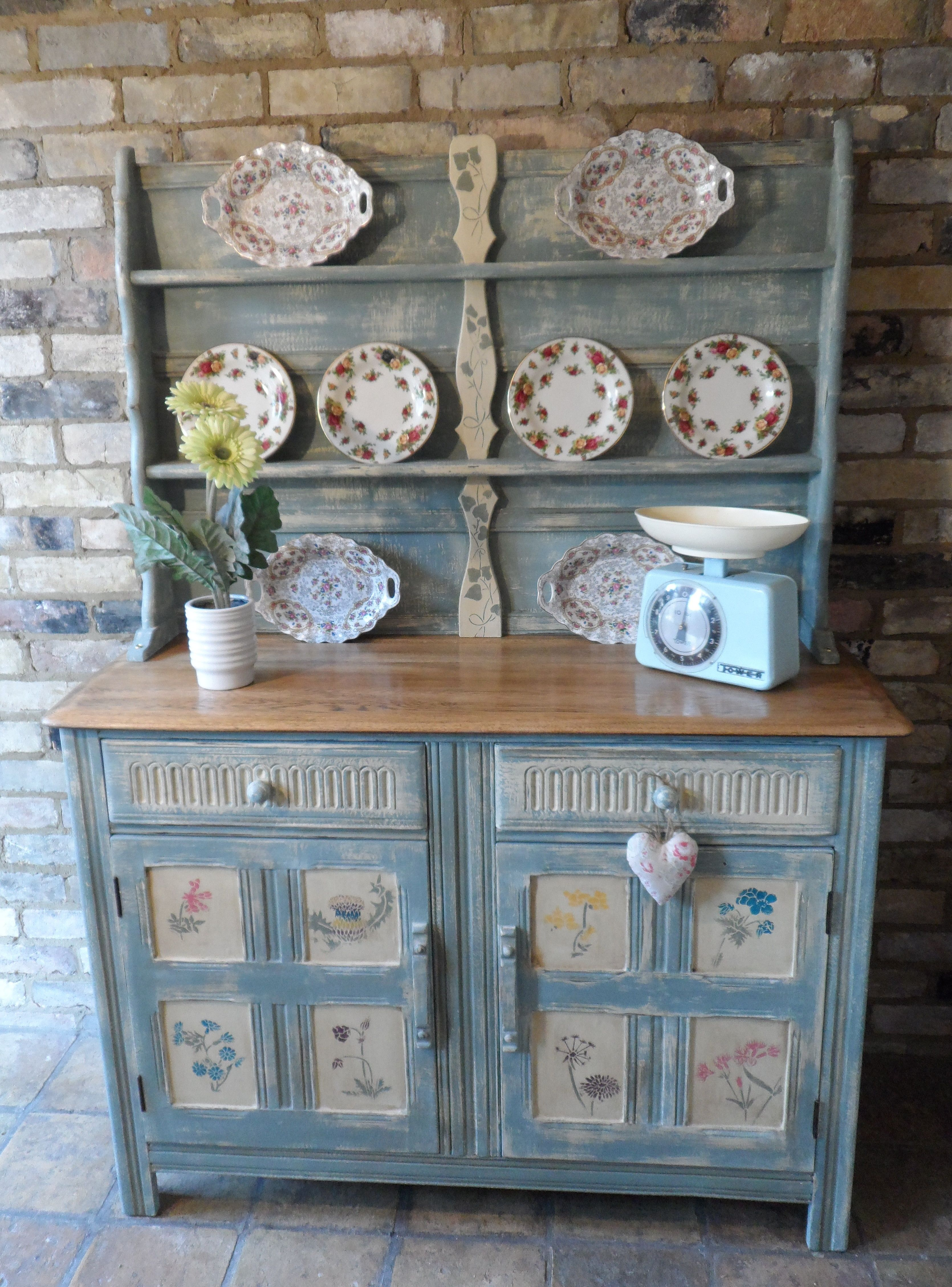 Annie Sloan painted Ercol dresser with wild flowers painted to door