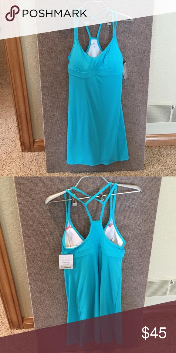 Athleta Swim dress Teal blue Coastline Swim dress by Athleta. NWT never worn. Strappy back, perfect fit! Swim suit material. Athleta Swim