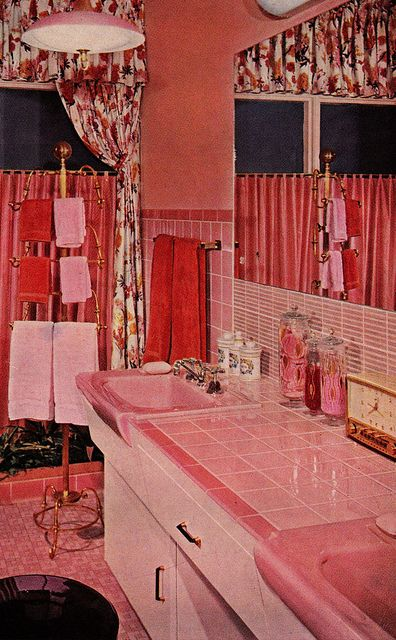 Photo of Pink bathroom with very busy curtains.