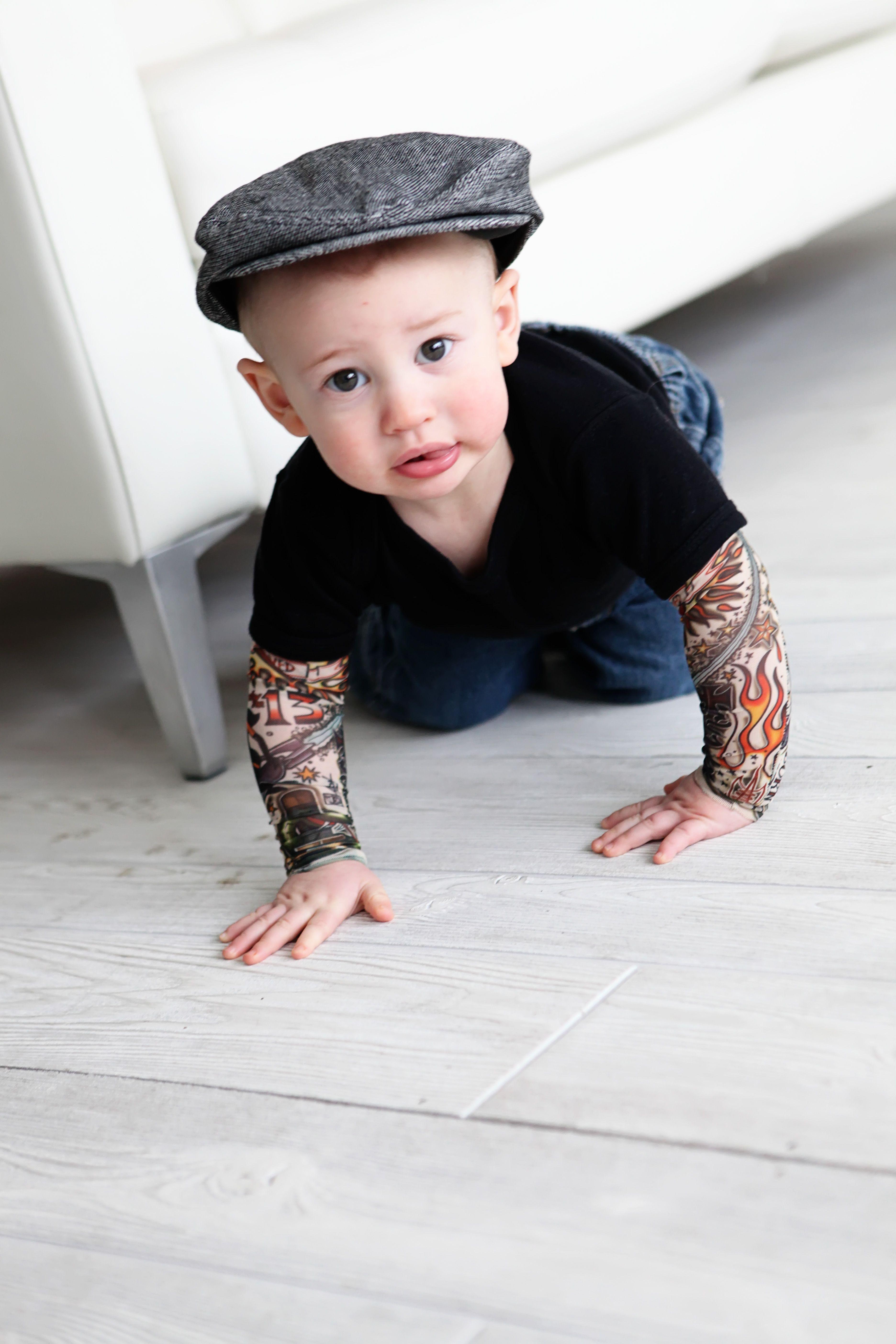 Black Heart breaker tattoo sleeve onesie!! haha Ali if you