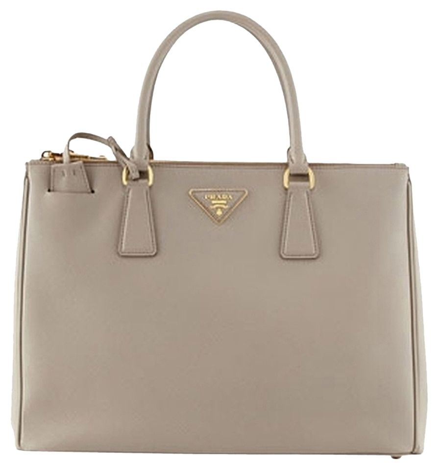 ab2fb4d55c Get one of the hottest styles of the season! The Prada Saffiano Double-zip  Executive (argilla) Grey Tote Bag is a top 10 member favorite on Tradesy.