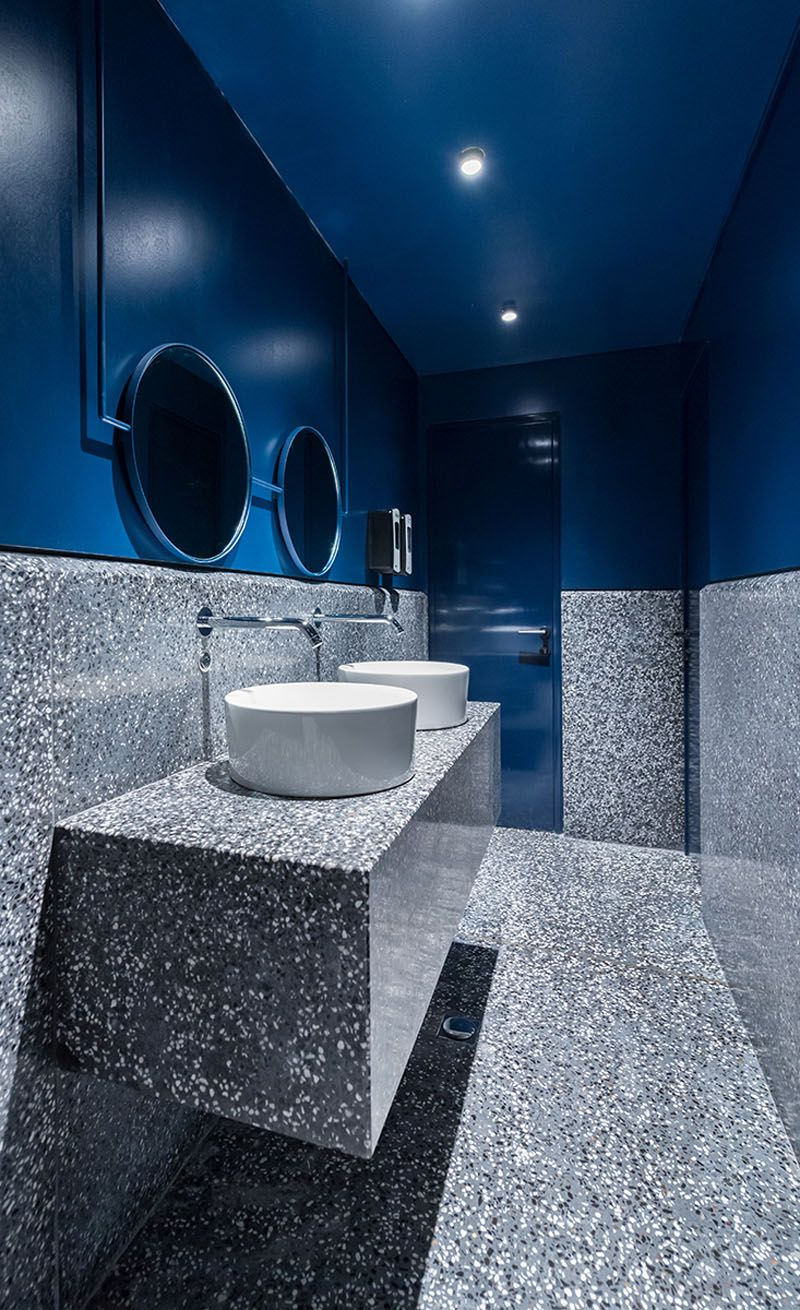 Amazing In This Modern Bathroom, A Dark Blue Paint Has Been Used To Create A Drama  Appearance That Ties Into The Blues Used Throughout The Rest Of The  Restaurant.
