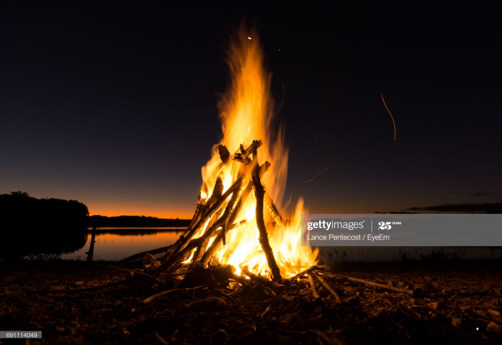 Stock Photo : Bonfire On Beach Against Sky At Night in ...