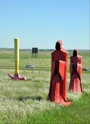 A pair of monks and an upside-down hammer stand firm in the breeze as cars whiz by Porter Sculpture Park in Montrose, S.D. The roadside attraction off Interstate 90 features more than 40 metal sculptures.