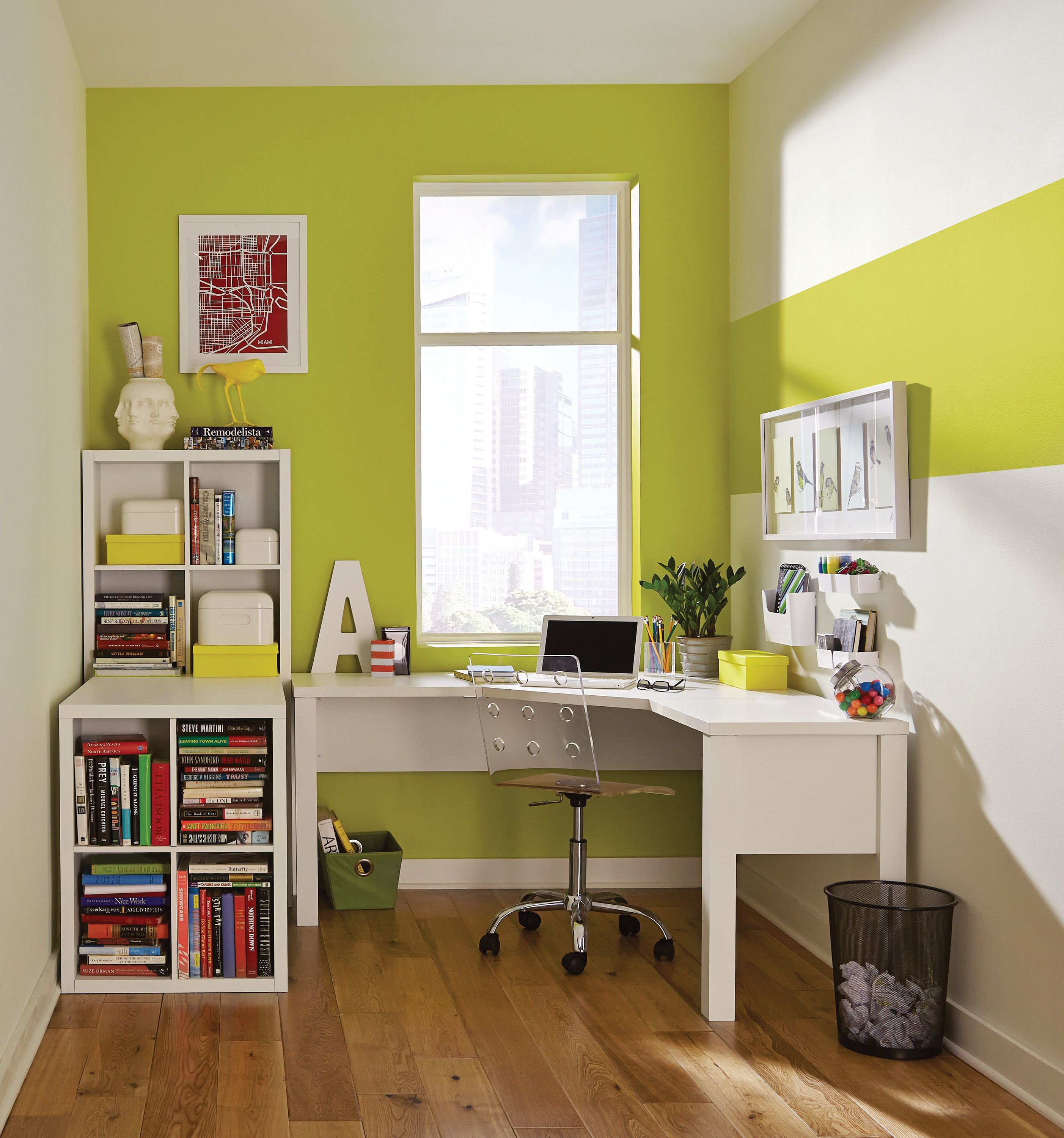 The accent wall in this tidy home office creates a strong