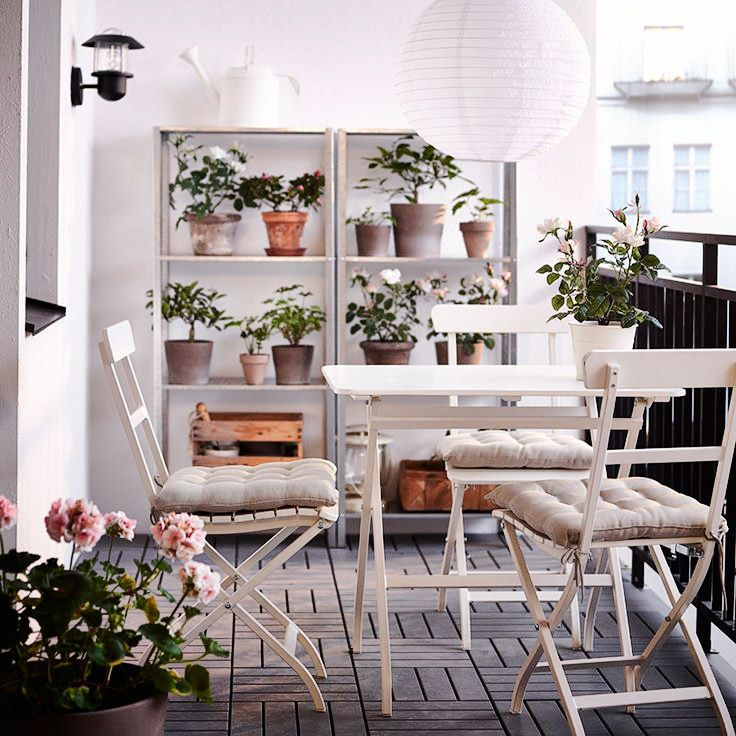 Outdoor patio with chic folding chairs and metal table