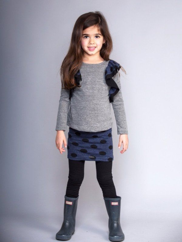 Girls top. Polka dot ruffle detail. Preshrunk. Made in the beautiful USA. Gentle wash cold, line dry or tumble dry low.