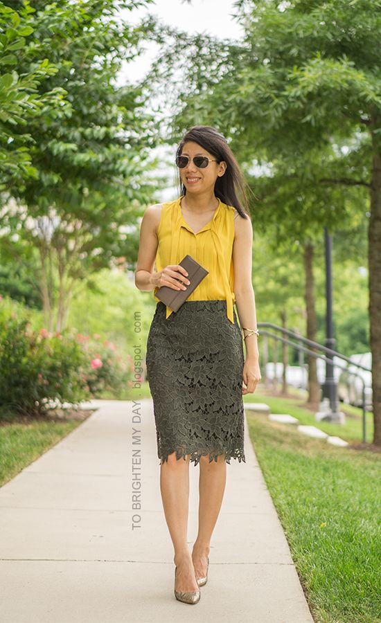 sleeveless mustard yellow pleated top gold cross bracelet taupe