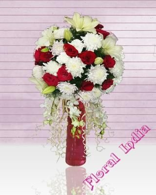 Perfecte round arrangement bouquet of white lily + White Crysenthimum/Carnations +Red Roses +White Orchid in cylender glass vase .