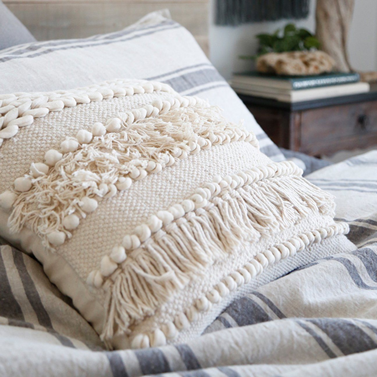 Hand-loomed tassels, braids, and pom poms this square pillow brings an earthy and textured feel to your home. 100% CottonHandmadeInserts Included