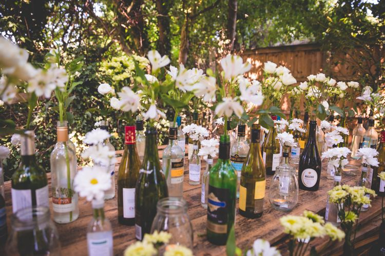 Bottle Flowers Table Decor Magical Outdoor Garden Festival Wedding http://realsimplephotography.net/