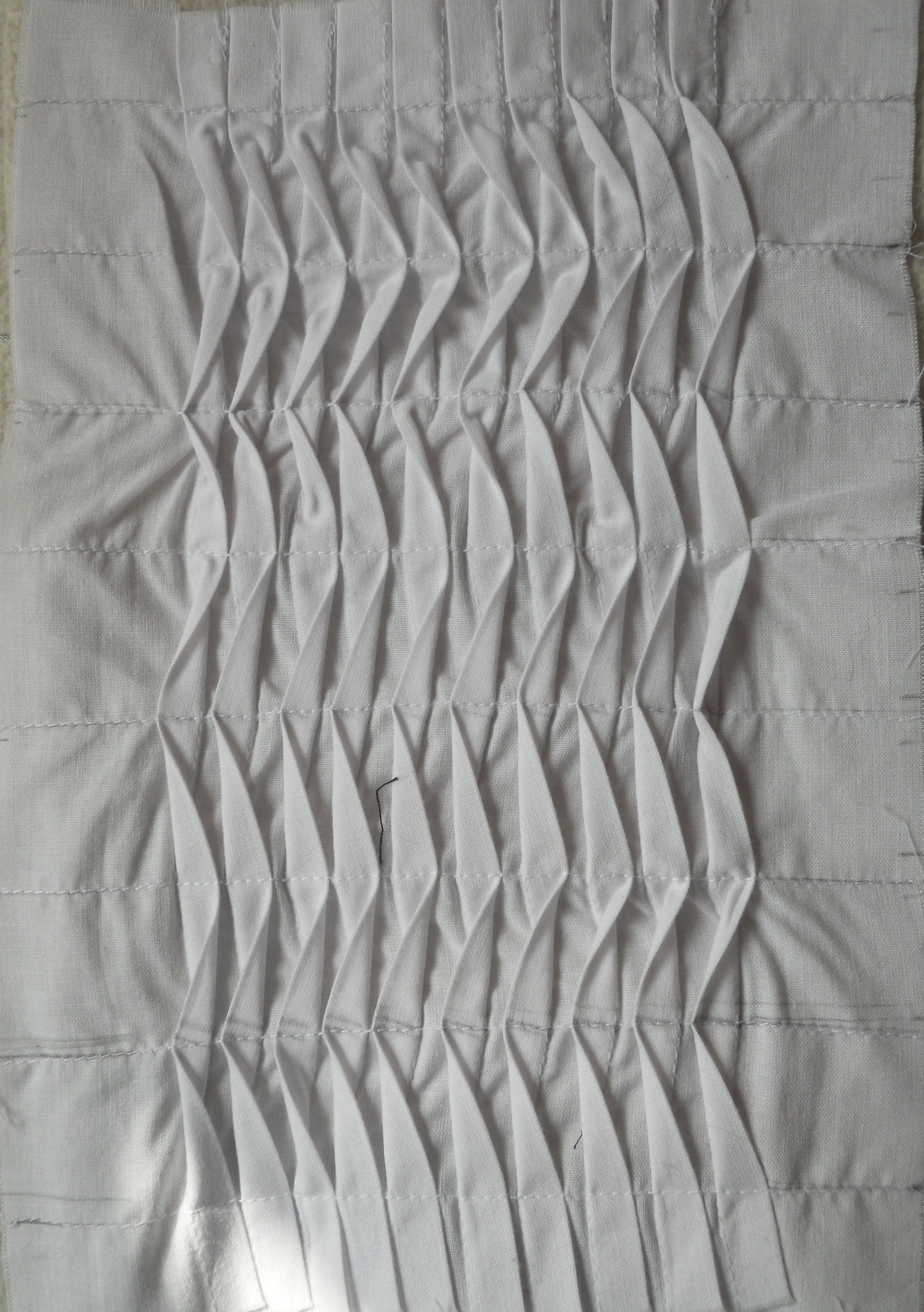 comment below and repin this fabric manipulation - undulating tucks