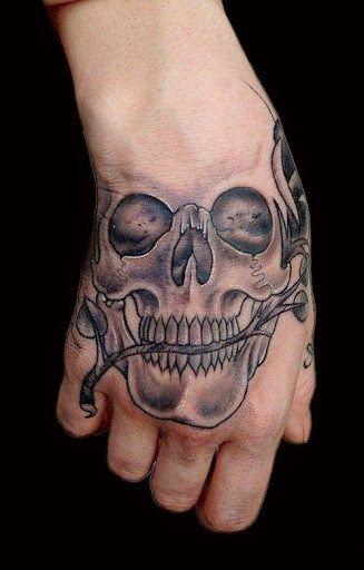 45 A Simple Skull Tattoo Design On Hand Skull Hand Tattoo Hand Tattoos Hand Tattoos For Guys