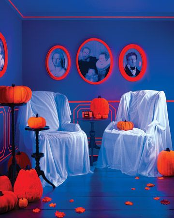Damn you Martha Stewart! you, with your awesome ideas! :)    Use fluorescent orange paper behind creepy pictures with cut out eyes and fangs under a blacklight for a cool effect. SUH-WEEEET!