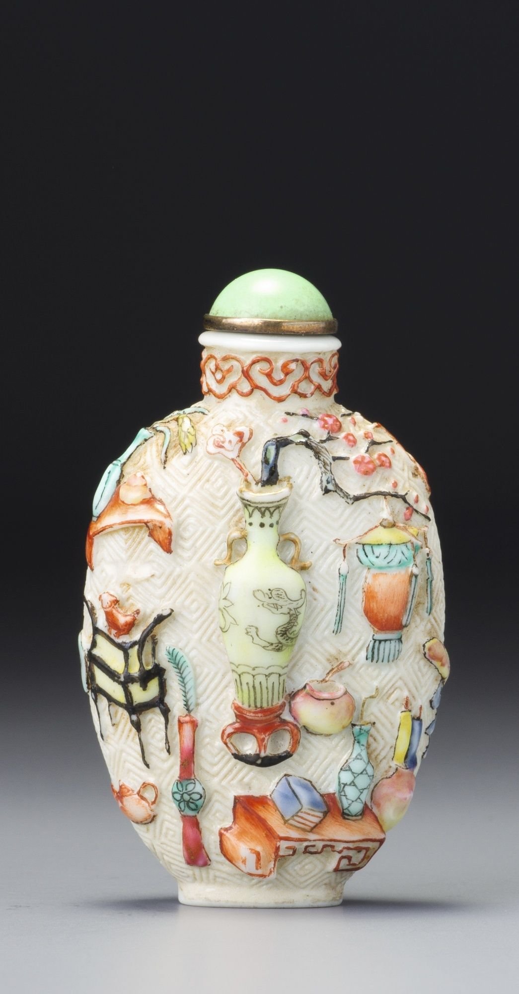 A MOULDED FAMILLE-ROSE PORCELAIN 'PRECIOUS OBJECTS' SNUFF BOTTLE SEAL MARK AND PERIOD OF QIANLONG