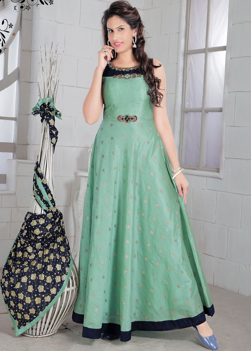 9e9928a0329542 Readymade mint  green sleeveless flared  kameez in art  silk embellished  with  resham  embroidery and  zari work.
