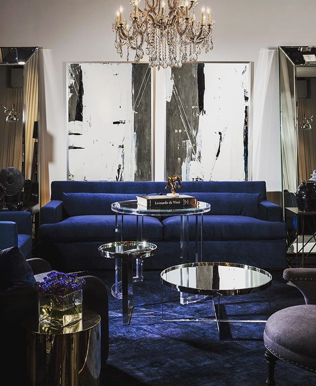 Love using a small round dining height table in front of a sofa instead of, or in this case clustered with, lower coffee tables  This is my Louise sofa all dressed up in deep rich blue velvet