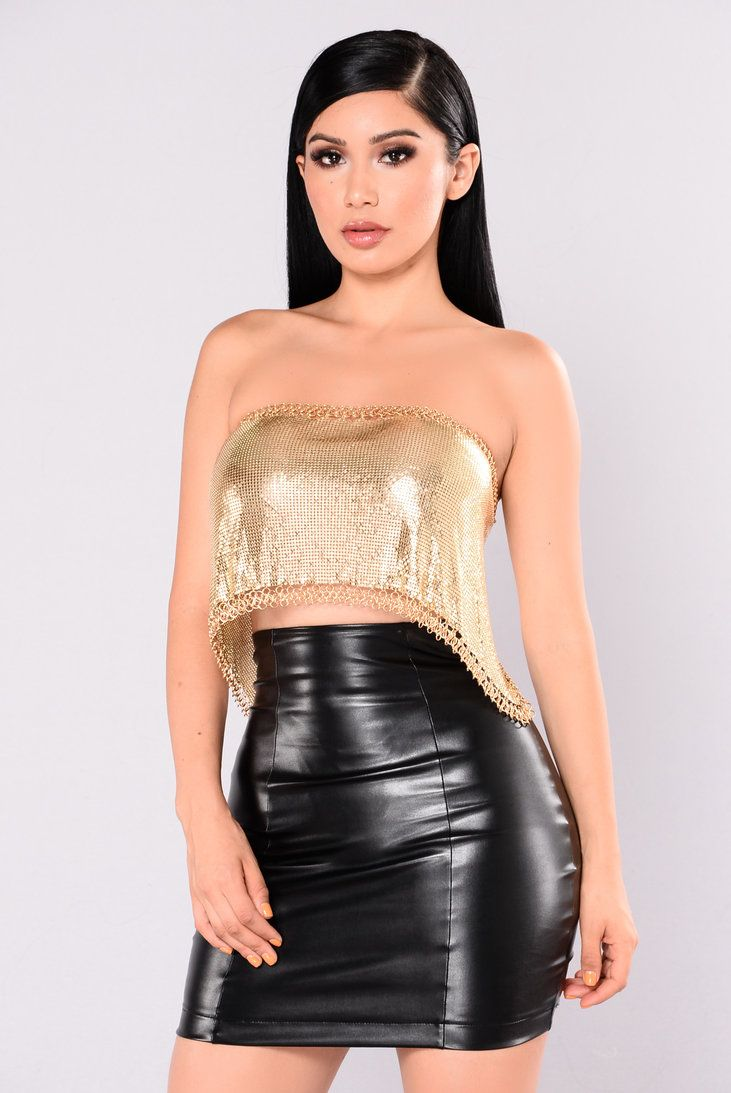 b5b2868b4a8 High waisted black leather miniskirt and metallic gold lamé tube top ...