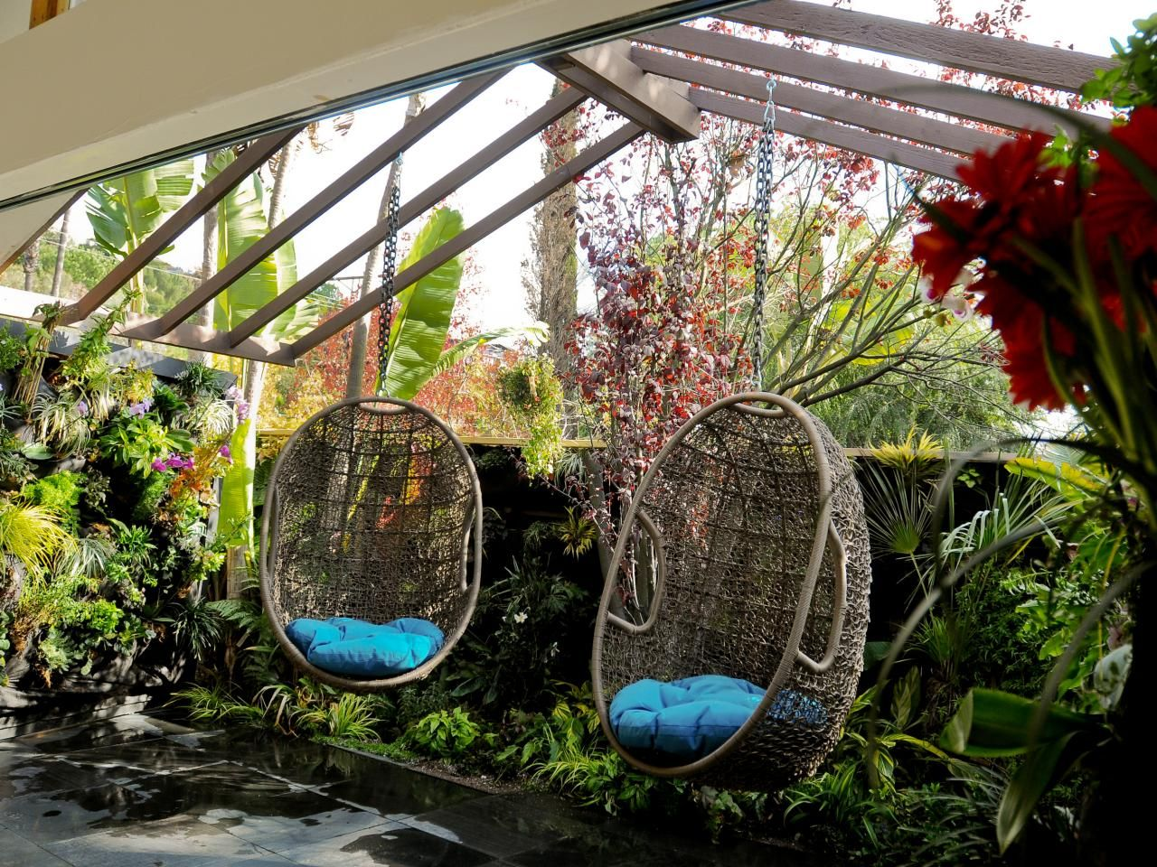Vertical garden design with orchids space saving backyard landscaping - 20 Stunning Outdoor Living Design Ideas 20 Stunning Outdoor Living Room Design Ideas Moving Doors Covered With A Vertical Garden Of Orchids