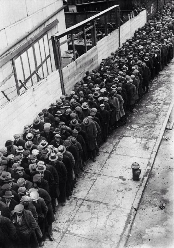 Men waiting in line for an opportunity at a job during the Great Depression, 1930.