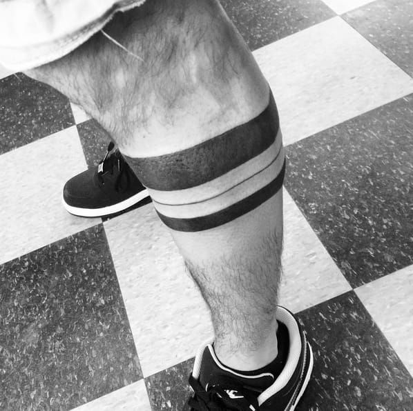 Blackwork leg band tattoo by Josh Barnes