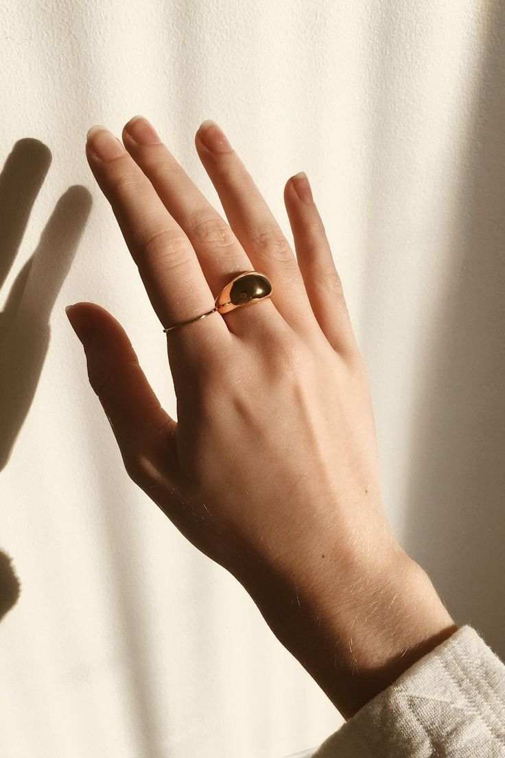 @corine.rio in the Stacker Ring and Dôme Ring.