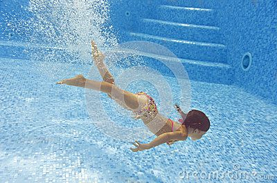 Beautiful girl dives and swims underwater in pool by Jaysi, via Dreamstime