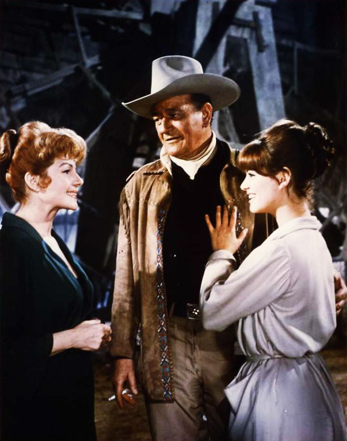Rita Hayworth, Claudia Cardinale and John Wayne in Circus World ...