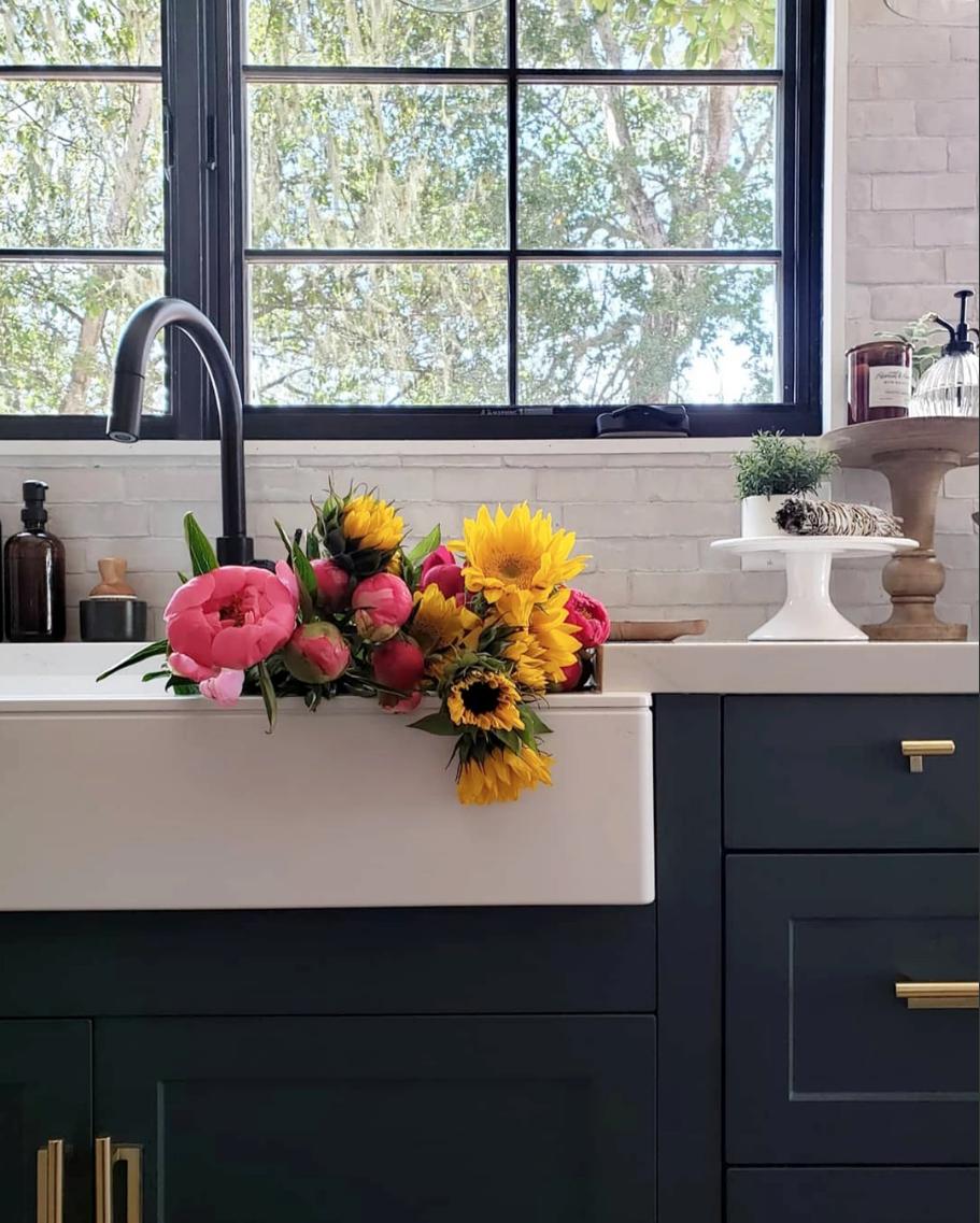 dark cabinets, brass hardware, white counters & sink ...