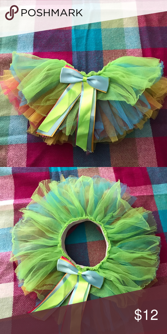 Baby Girls TuTu Baby girls adorable colorful tutu with large bow in front. Perfect for dress up, fun outfits or photo shoots. These have been gently used for photo sessions. They do not have a size but have fit my daughter at around 1 - 2.5 years. It is elastic and stretches without loosing the shape of the tutu. Mud Pie Other