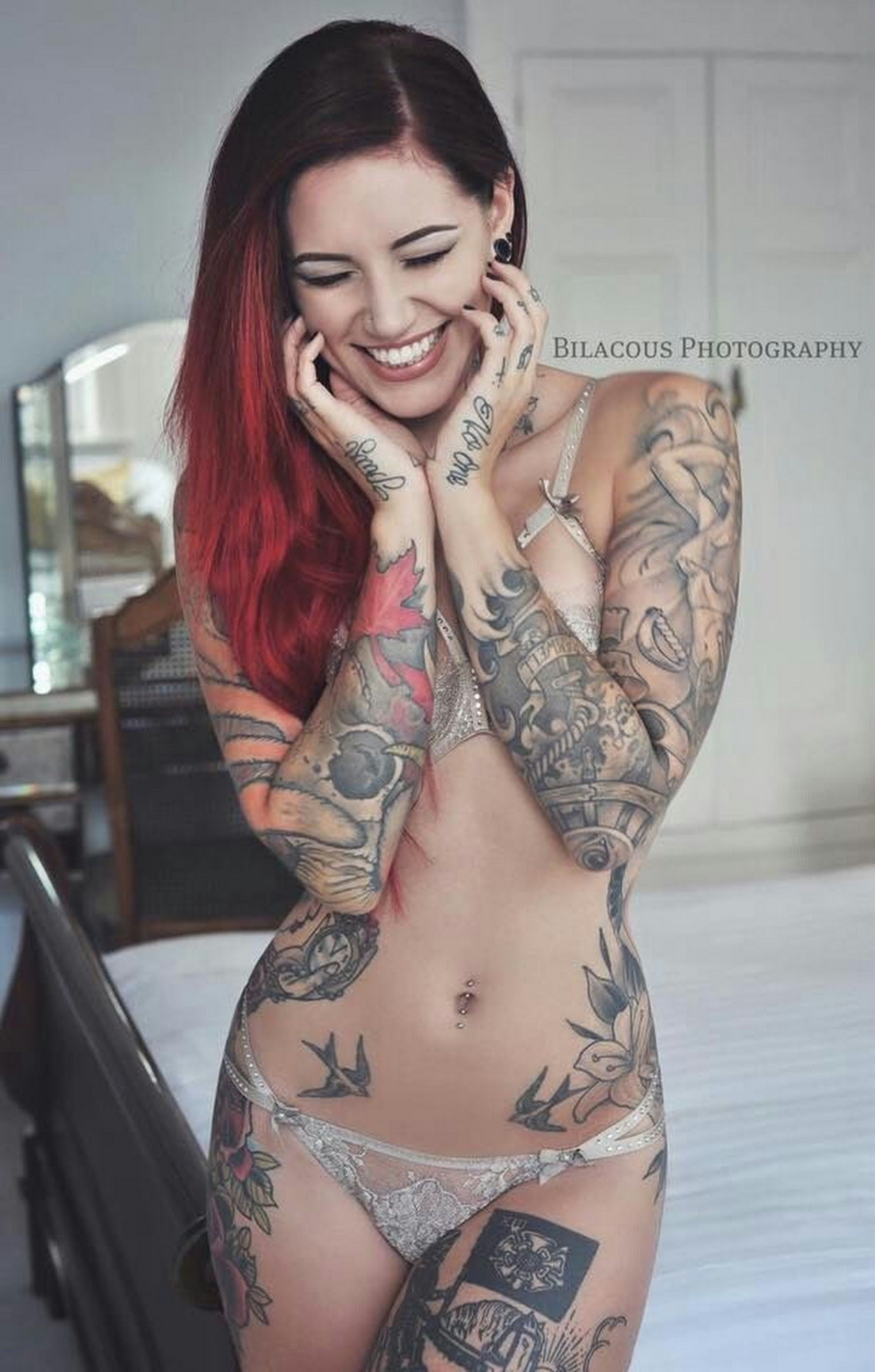 beautiful naked woman with tattoo