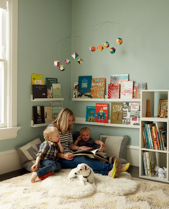 hang two rows of low book ledges to create a reading