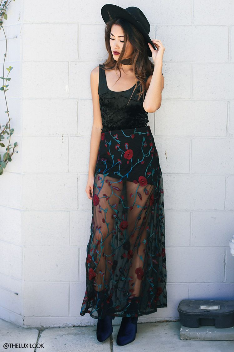a semi sheer mesh maxi skirt featuring floral embroidery